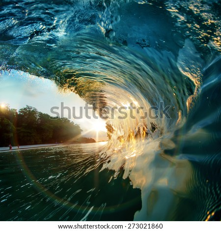 Colorful Ocean Surfing Wave at the sunset - stock photo