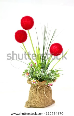 Colorful of Artificial Flower Arrangement on white background - stock photo