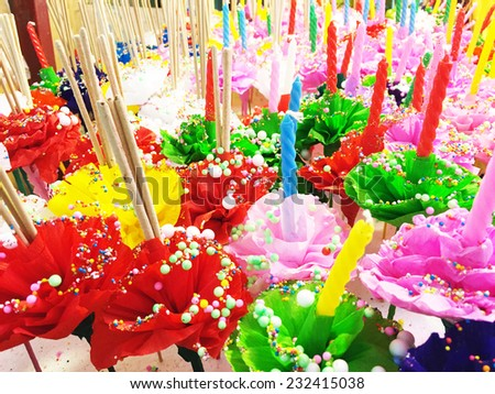 Colorful of Artificial flowers with candle for decoration, Loy Kra Tong Festival - stock photo
