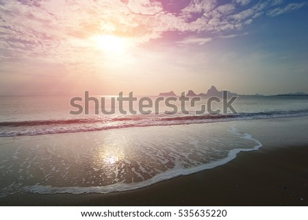 Colorful of beautiful sunrise over sea at Ao Prachuap, Prachuap Khiri Khan province in Southern Thailand