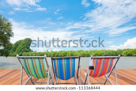 Colorful of desk chairs and blue sky background