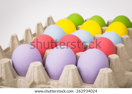 colorful of eggs for holiday easter festival on crate, can use as background - stock photo