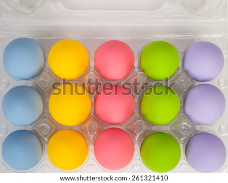 colorful of eggs for holiday easter festival on plastic package, can use as background - stock photo