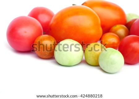 colorful of fresh tomatoes isolated on a white background with copy space for text - stock photo