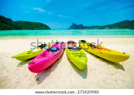 colorful of kayaks boat on the beach  - stock photo