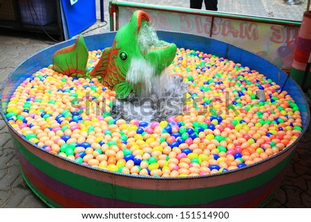 colorful of lucky balls floated in basin, egg balls for gamble - stock photo