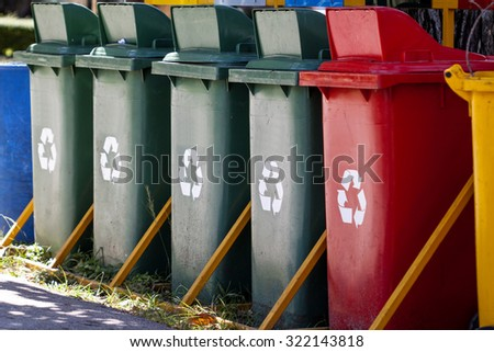 colorful of recycle bins in the garden - stock photo