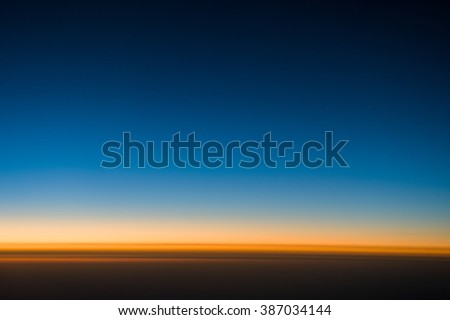 Colorful of Shade from Blue and orange gradation of sunset from sky with Space for text in template background - stock photo