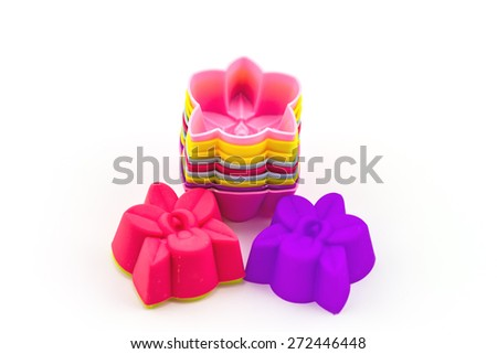 Colorful of silicone molds for baking, object on a white background - stock photo
