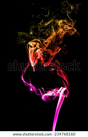 Colorful of smoke on a black background. - stock photo