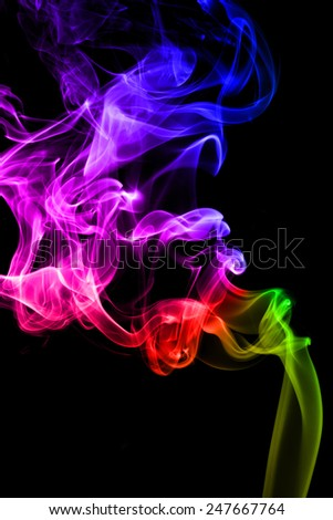 Colorful of smoke on black background. - stock photo