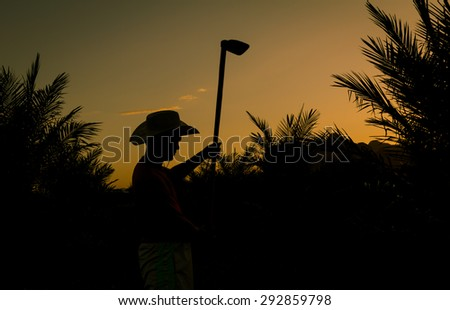 colorful of sunset sky,oil palm and farmer  the beautiful yellow sunset. Autumnal landscape. - stock photo