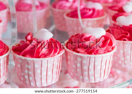 Colorful of sweet cup cake on plate . - stock photo