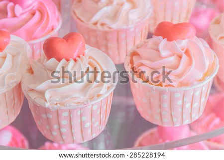 Colorful of sweet cup cake on plate, vintage color.