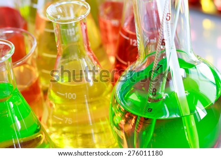 Colorful of the solution in laboratory glassware, flask beaker and pipette for science and technology concept. - stock photo