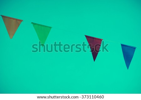 colorful of triangle flag on dark green  background. vintage tone process - stock photo