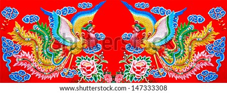 Colorful of twin phoenix on wall of  joss house