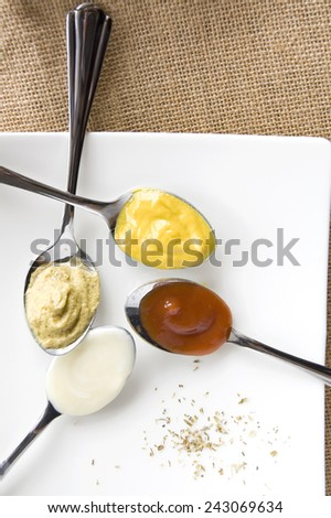 colorful of variety condiment on spoon