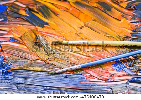 Colorful oil paints and brushes on a palette