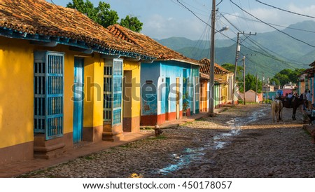 Colorful old buildings line the streets of Trinidad, Cuba.
