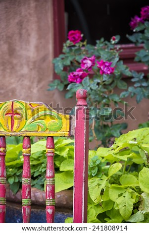 Colorful old chair sitting outside on Canyon Road in Santa Fe, NM - stock photo