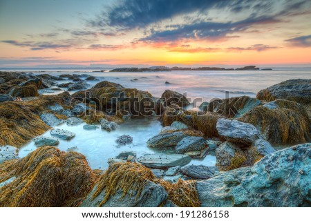Colorful  orange, blue and pink HDR sunrise seascape of rocky coastline at Sachuest Point Wildlife Refuge in Middletown Rhode Island. / Rocky Sunrise Seascape HDR in America. - stock photo