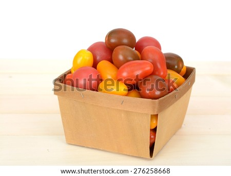 colorful organic cherry tomatoes on bucket on white background - stock photo