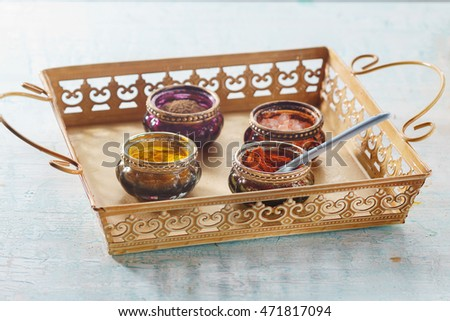 Colorful oriental spices on blue vintage wooden table