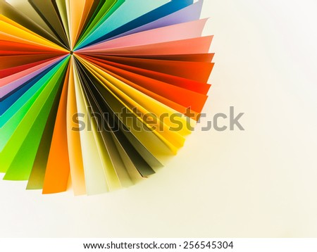 colorful origami fan pattern on white background - stock photo