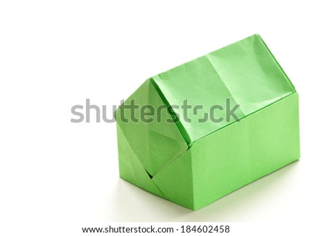 colorful origami paper house on a white background - stock photo