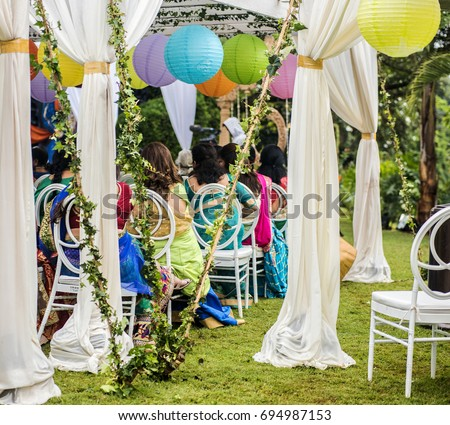 Colorful Outdoor Lawn Tent And Garden Setting For Indian Pre Wedding  Ceremony. White Silk
