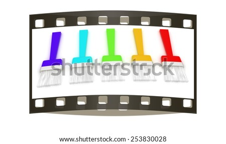 Colorful paint brushes on a white background - stock photo
