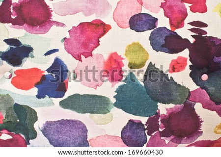 Colorful paint marks on an upholstery surface - stock photo