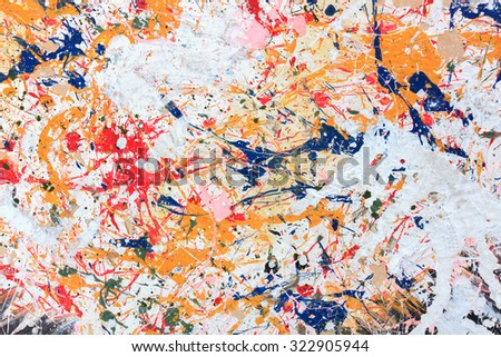 colorful paint on wood background.