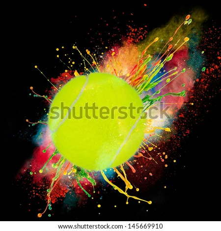 Colorful paint splashing with tennis ball isolated on black - stock photo