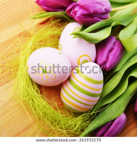 Colorful painted easter eggs  and bouquet tulip - stock photo