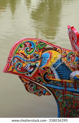 Colorful painting on traditional wooden boat