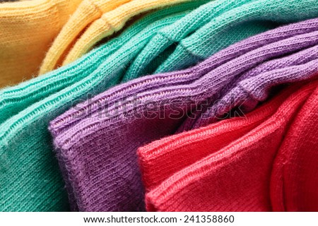 Colorful pairs of socks in close up detail - stock photo