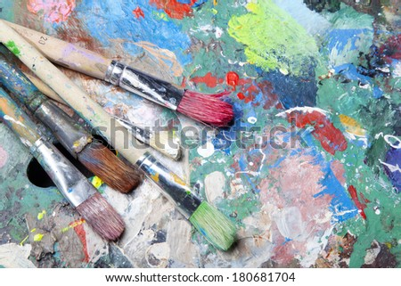 colorful palette and paint brushes - stock photo