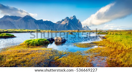 Colorful panorama of the Stokksnes headland on southeastern Icelandic coast with Vestrahorn (Batman Mountain). Iceland, Europe. Artistic style post processed photo.