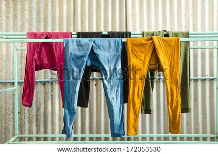 Colorful pants on a clothesline to dry