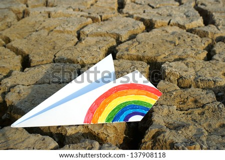 colorful paper airplane on ground. - stock photo