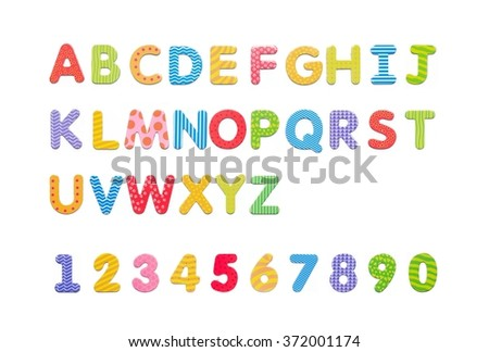 Colorful paper alphabet magnets on a whiteboard. Letters set isolated on white background - stock photo