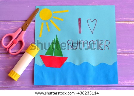 Colorful paper card with ship, sea, sun and words I love summer. Scissors and glue stick on lilac wooden background. Preschool and kindergarten paper crafts. Summer fun background.  - stock photo