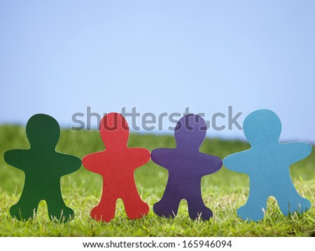 colorful  paper chain on the grass - stock photo
