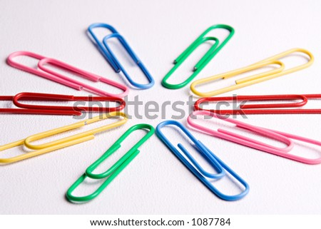 Colorful paper clips on a white background