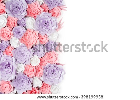 Colorful paper flowers background with space for your text. Floral backdrop with handmade roses for wedding day or birthday - stock photo