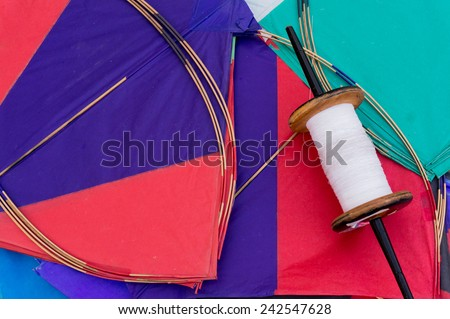Colorful paper kites and string used in the sport of kite fighting. Traditionally flown on Makar Sankranti or on Republic day - stock photo