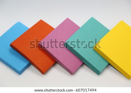 Colorful paper note on white background.