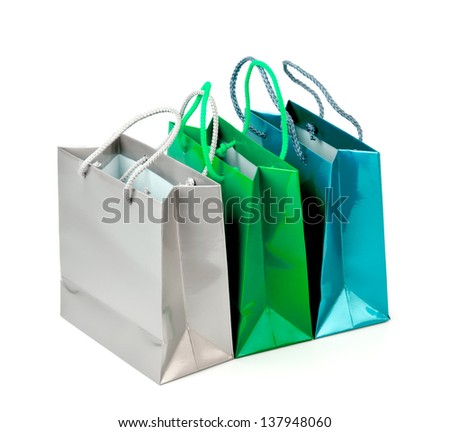 Colorful paper shopping bags isolated on white background.